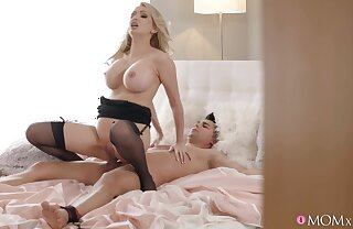 Half-naked blondie in stockings rides an obedient cock