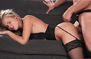 StrapOn Babe in arms champaign stocking and suspenders gets DP from strapon cock